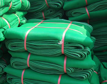 Several pieces green construction safety net packed with packing belt