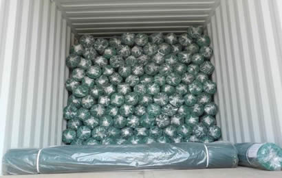 Many rolls agriculture shade net packed with poly bags in container