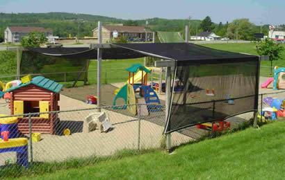 A playground is installed with black agriculture shade net