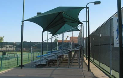 A stands is installed with black agriculture shade net