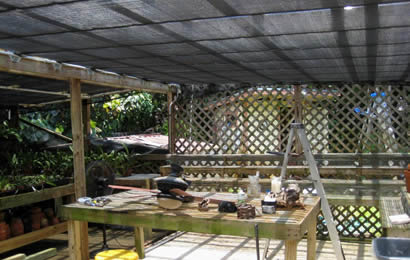 A patio is installed with black agriculture shade net