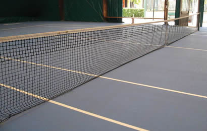 2 pieces black tennis net with white head band are installed indoor